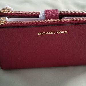 10dbb1dc5195 Michael Kors Bags - Michael Kors Adele Leather Smartphone Wristlet